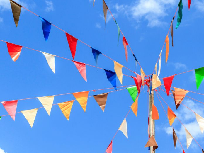 flags against a blue sky at the best St. Augustine Events