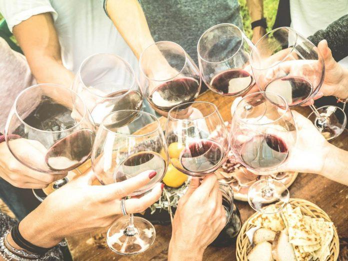 group of friends enjoying wine at san sebastian winery