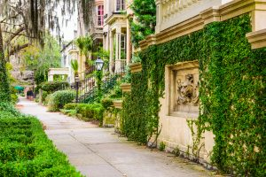 Savannah, Georgia, USA historic downtown sidewalks and townhouses.